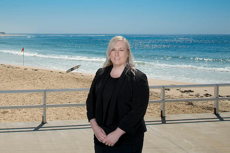 Hannah Pike Standing Near The Beach