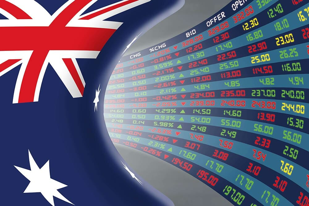 Franking Credits Explained Against A Backdrop Of The Australian Flag And Bid/ Offer Rates On A Screen