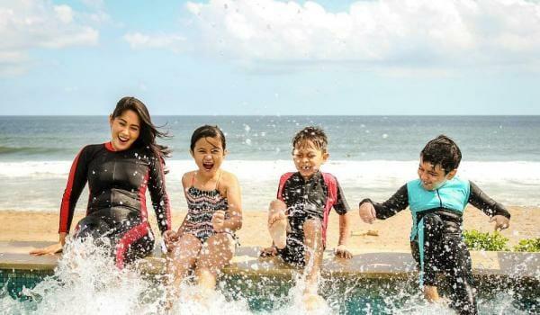 Kids Enjoying Themselves On On The Beach