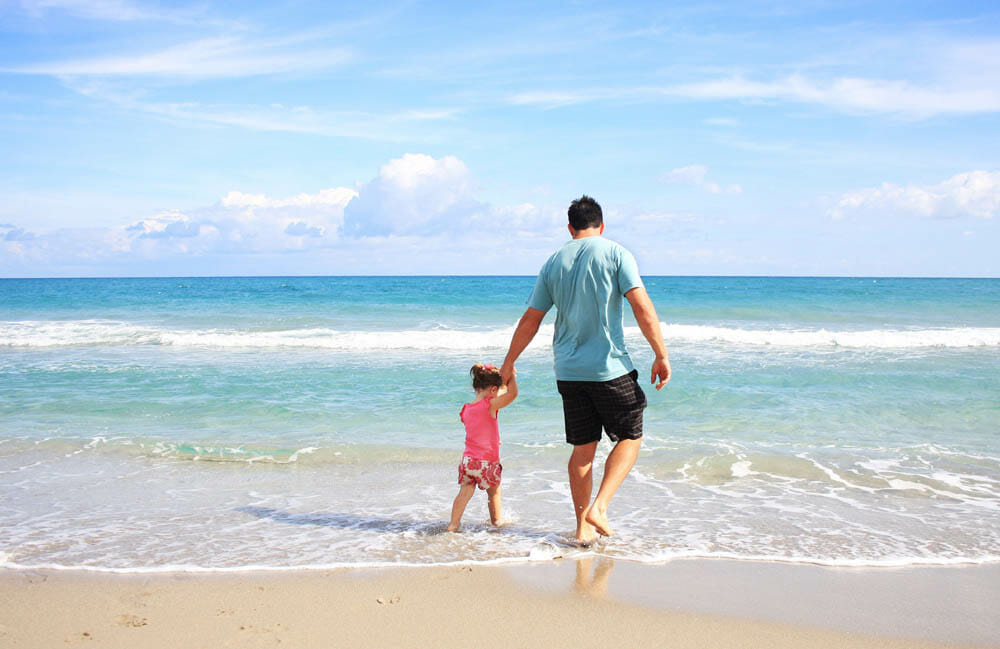 Dad And Daughter On The Beach By The Sea