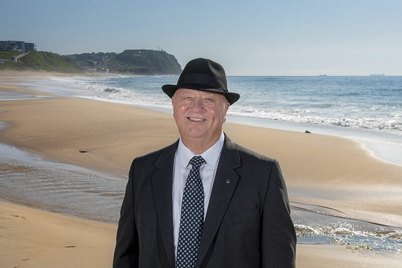 Gary Watson With Hat Standing By The Beach