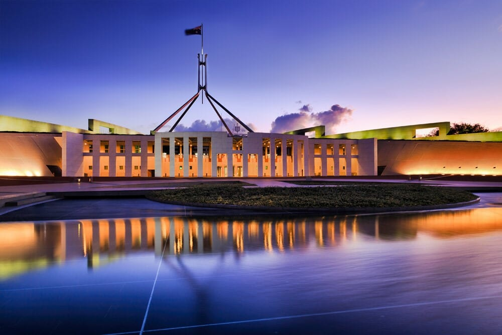 Parliament House with the question How will the Federal Budget affect you?