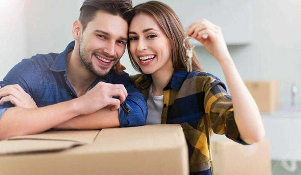 Young Couple Pleased To Have Found Top 4 Tips To Pay Off Your Mortgage Faster